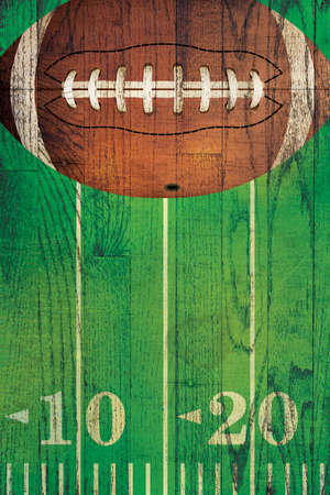 An American football and field painted over a textured hardwood floor background. Stock Photo