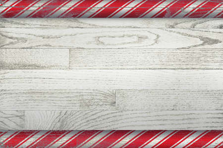 A Christmas candy cane background painted over a whitewashed wooden board. Stock Photo