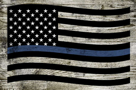 enforcement: A waving police and law enforcement support flag over a dirty stained wooden board background Stock Photo