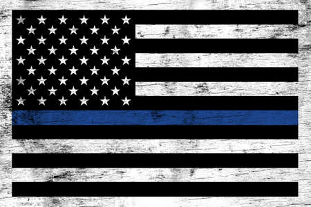 A police and law enforcement support flag stained over a weathered white wooden background. Archivio Fotografico