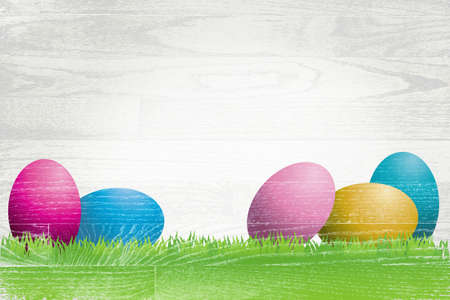 white washed: Colorful Easter eggs and grass painted over a white washed wooden plank board. Stock Photo