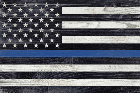 A law enforcement police support flag painted on white washed wood grained boards. Banque d'images