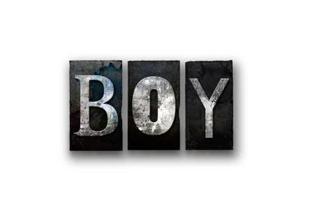 boyhood: The word BOY written in vintage, dirty, ink stained letterpress type and isolated on a white background.