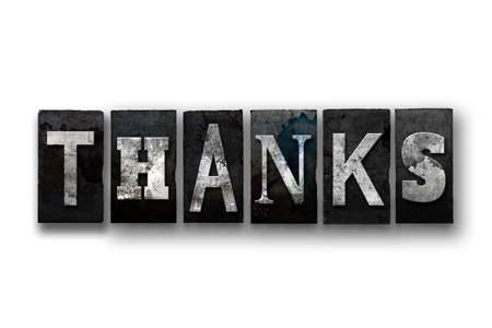 acknowledgment: The word Thanks written in vintage, dirty, ink stained letterpress type and isolated on a white background.