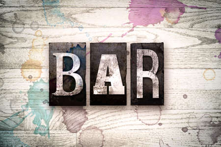 type bar: The word BAR written in vintage, dirty metal letterpress type on a whitewashed wooden background with ink and paint stains.