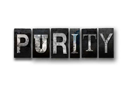 morality: The word PURITY written in vintage, dirty, ink stained letterpress type and isolated on a white background.