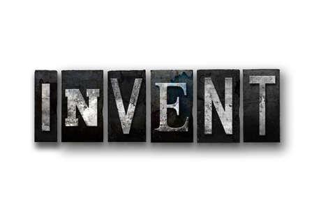 """Het woord """"INVENTE"""" geschreven in vintage, vuile, inkt bevlekte boekdruk type en geïsoleerd op een witte achtergrond."""