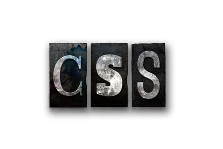 css: The word CSS written in vintage, dirty, ink stained letterpress type and isolated on a white background.