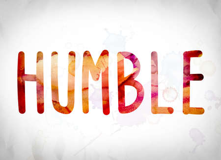 bashful: The word Humble written in watercolor washes over a white paper background concept and theme. Stock Photo