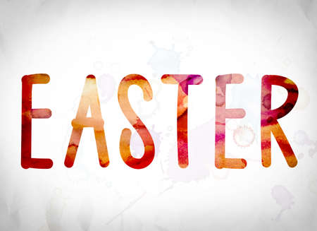 The word Easter written in watercolor washes over a white paper background concept and theme. Stock Photo