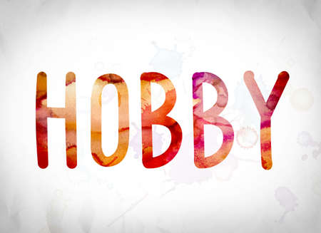 The word Hobby written in watercolor washes over a white paper background concept and theme.