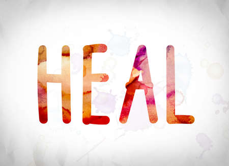 The word Heal written in watercolor washes over a white paper background concept and theme.