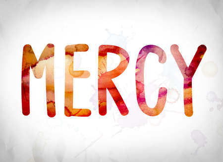 The word Mercy written in watercolor washes over a white paper background concept and theme. Stock Photo