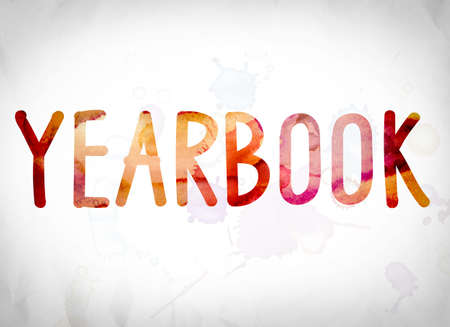 chronicle: The word Yearbook written in watercolor washes over a white paper background concept and theme. Stock Photo