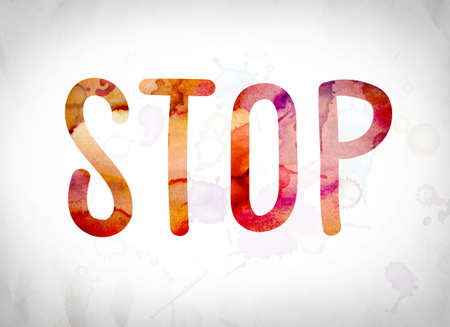 stoppage: The word Stop written in watercolor washes over a white paper background concept and theme. Stock Photo