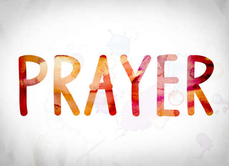 The word Prayer written in watercolor washes over a white paper background concept and theme. Stock Photo