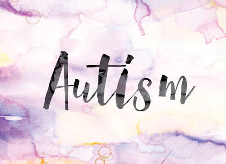 developmental disorder: The word Autism painted in black ink over a colorful watercolor washed background concept and theme.