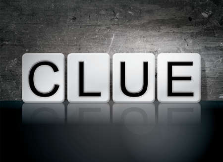 sleuth: The word Clue written in white tiles against a dark vintage grunge background. Stock Photo