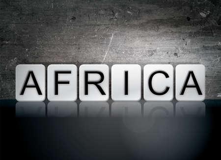 The word Africa written in white tiles against a dark vintage grunge background.