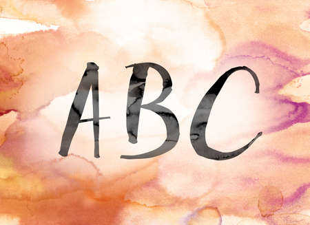 The word ABC painted in black ink over a colorful watercolor washed background concept and theme. Stock Photo