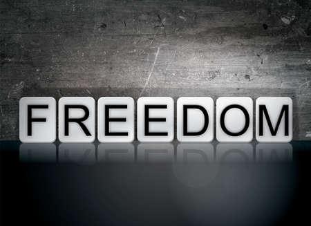 abolition: The word Freedom written in white tiles against a dark vintage grunge background.