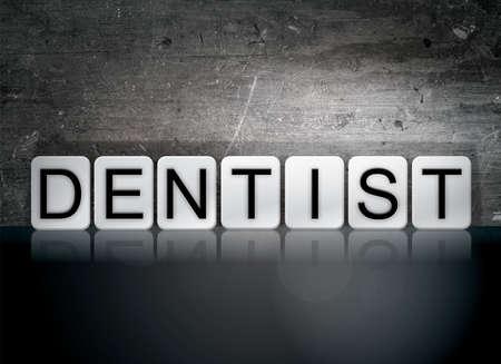 The word Dentist written in white tiles against a dark vintage grunge background.