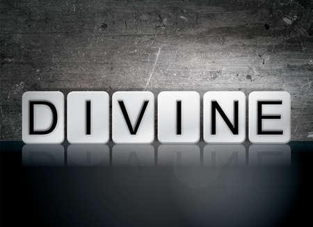 godlike: The word Divine written in white tiles against a dark vintage grunge background. Stock Photo