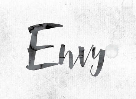 envy: The word Envy concept and theme painted in watercolor ink on a white paper.