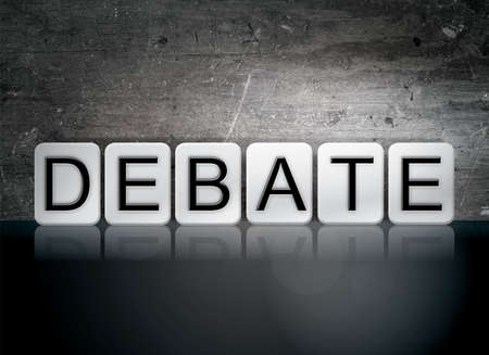 rebuttal: The word Debate written in white tiles against a dark vintage grunge background. Stock Photo