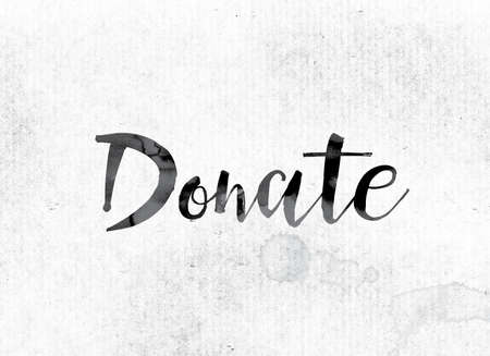 The word Donate concept and theme painted in watercolor ink on a white paper. Stock Photo