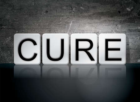 clinical trial: The word Cure written in white tiles against a dark vintage grunge background.