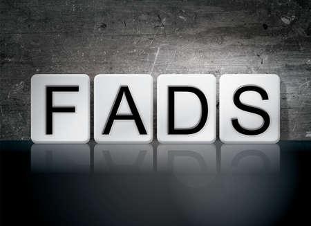 craze: The word Fads written in white tiles against a dark vintage grunge background.