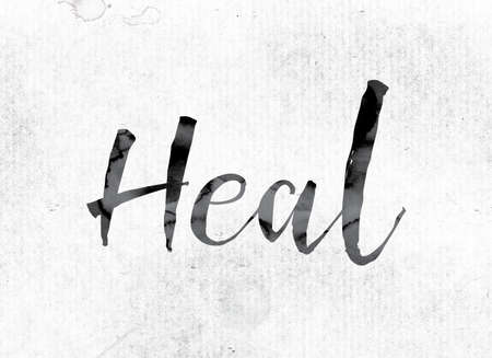 The word Heal concept and theme painted in watercolor ink on a white paper. Stock fotó
