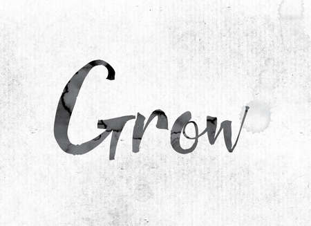 The word Grow concept and theme painted in watercolor ink on a white paper. Stock Photo