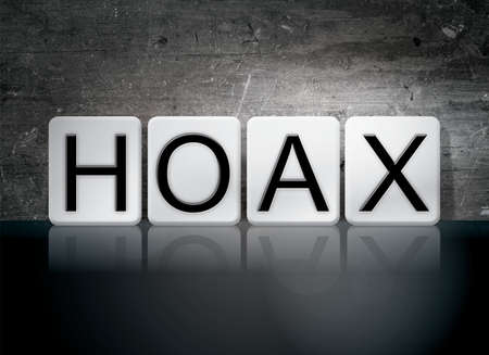 hoax: The word Hoax written in white tiles against a dark vintage grunge background. Stock Photo