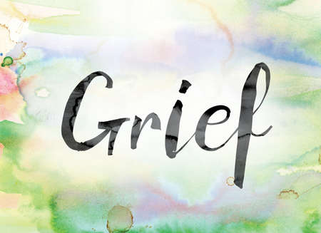 grief: The word Grief painted in black ink over a colorful watercolor washed background concept and theme.