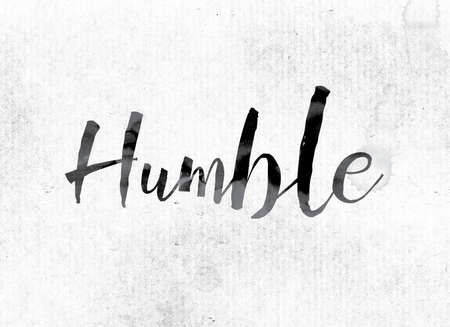 humbled: The word Humble concept and theme painted in watercolor ink on a white paper. Stock Photo