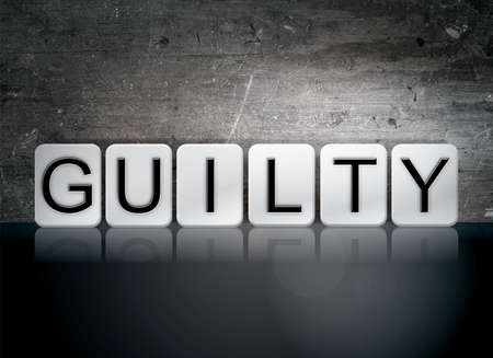 defendant: The word Guilty written in white tiles against a dark vintage grunge background.