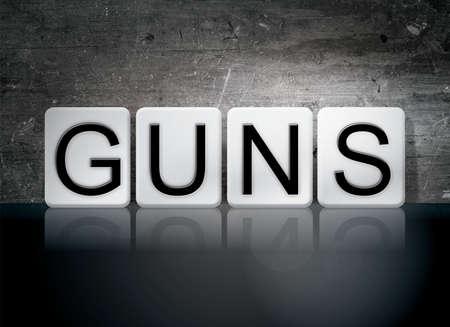 muzzleloader: The word Guns written in white tiles against a dark vintage grunge background.