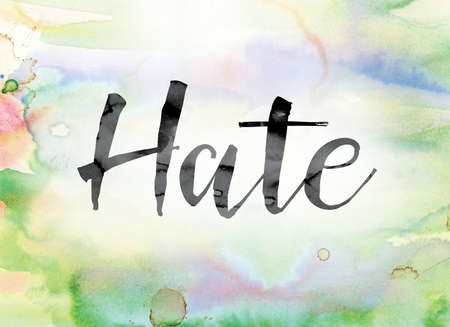 disdain: The word Hate painted in black ink over a colorful watercolor washed background concept and theme. Stock Photo