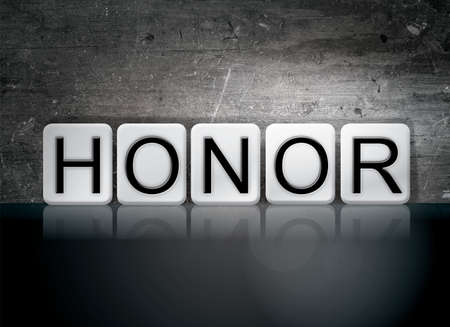 honored: The word Honor written in white tiles against a dark vintage grunge background. Stock Photo
