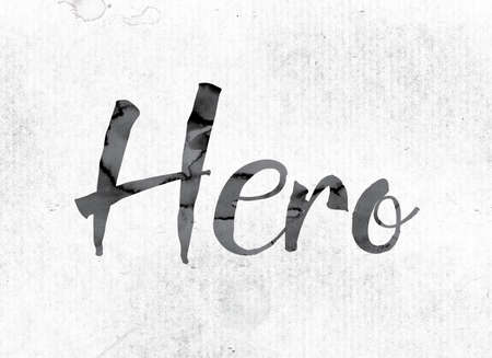 heroism: The word Hero concept and theme painted in watercolor ink on a white paper. Stock Photo
