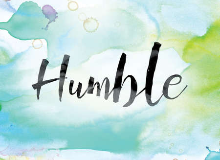 The word Humble painted in black ink over a colorful watercolor washed background concept and theme. Stock Photo