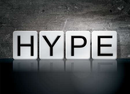 hype: The word Hype written in white tiles against a dark vintage grunge background.