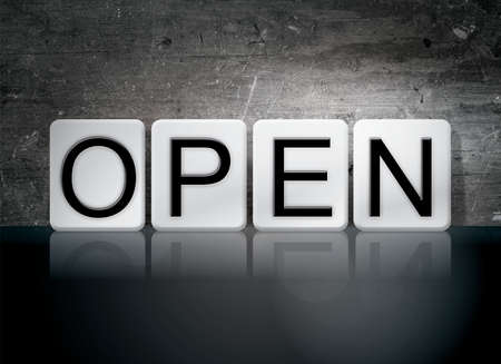 unopen: The word Open written in white tiles against a dark vintage grunge background. Stock Photo