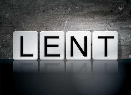 observance: The word Lent written in white tiles against a dark vintage grunge background. Stock Photo