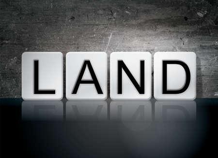 The word Land written in white tiles against a dark vintage grunge background.