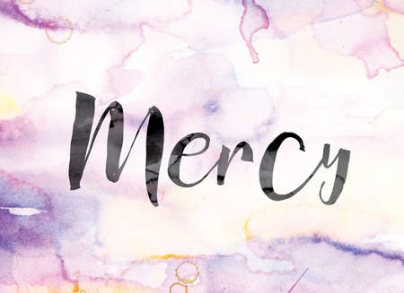 clemency: The word Mercy painted in black ink over a colorful watercolor washed background concept and theme.