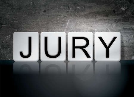 The word Jury written in white tiles against a dark vintage grunge background. Stock Photo