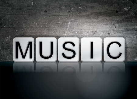 chorale: The word Music written in white tiles against a dark vintage grunge background. Stock Photo